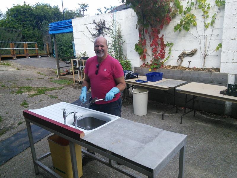 Volunteer Mark puts finishing touches to washing up station